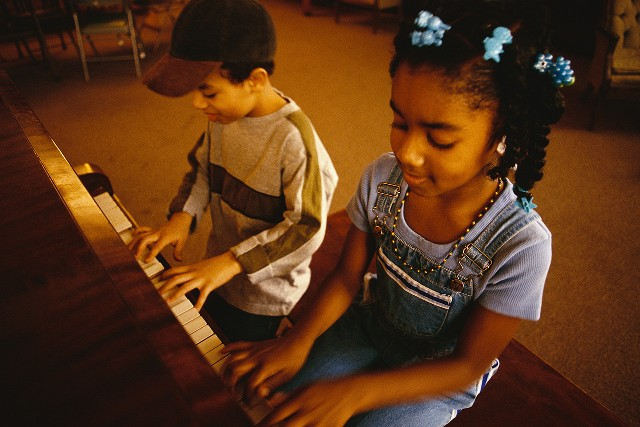 Children Playing Piano